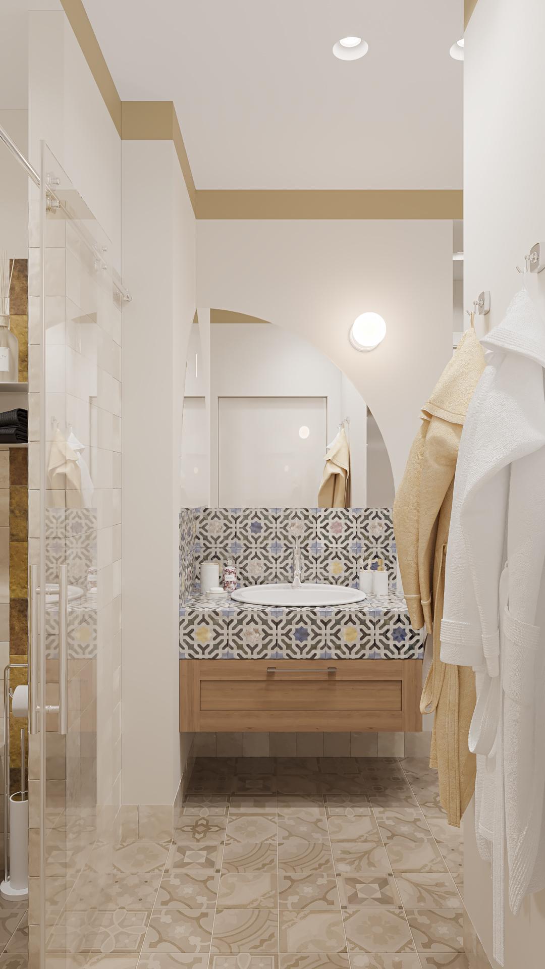 фото:В нашей планировке, ванная комната является первым приватным помещением хозяев, а следом идет спальная комната. Т.е. ванная комната имеет две межкомнатные двери и является проходной. Интересный прием реализовали в зеркалах над умывальником - зеркала расположены в углу в двух плоскостях, совместно образуя арку и отражая одновременно два входа в ванну. Складывается очень интересный эффект в отражениях этих зеркал